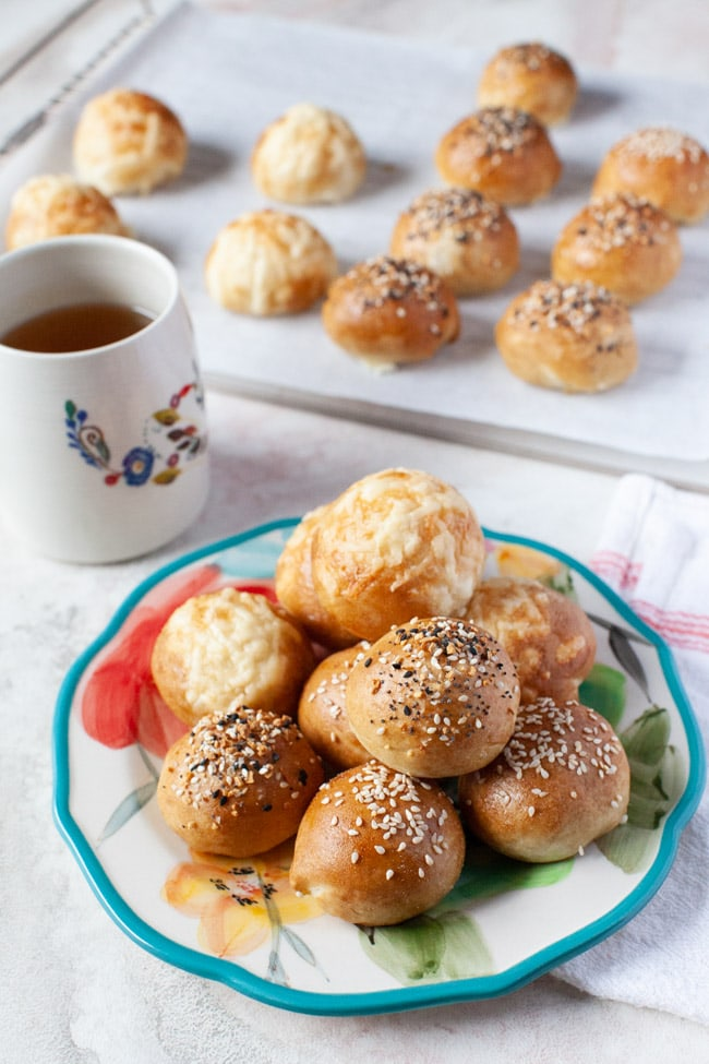 stuffed bagel bites on a plate with tea in the background